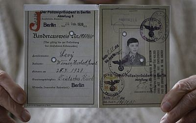 Illustrative: The identity card of Herbert Levy, who was brought to England by Kindertransport from Berlin in Germany in 1939 to escape Nazi persecution, at his home in London, Thursday, November 21, 2013. (Photo credit: AP Photo/Kirsty Wigglesworth)