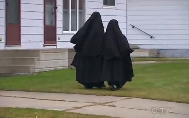 Lev Tahor girls walking in Chatham, Ontario. (photo credit: YouTube screenshot)