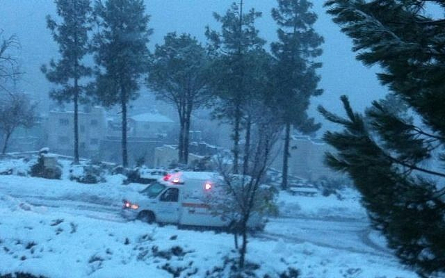An MDA ambulance driving along a snow-covered route Friday, December 13, 3013. (Photo credit: Magen David Adom in Israel)