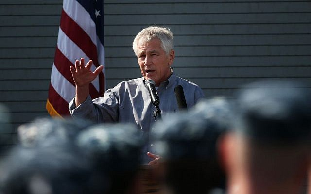 Chuck Hagel speaks to military service members aboard the USS Ponce in Manama, Bahrain, Friday. (photo credit: AP/Mark Wilson, Pool)