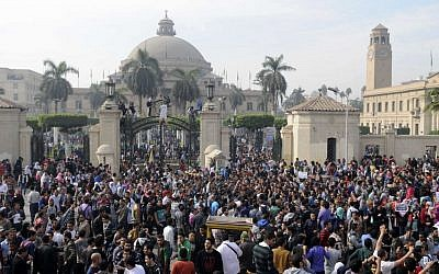 Student protesters gather outside the main gate of Cairo University, Cairo, Egypt Sunday, Dec. 1, 2013 before marching to Tahrir square. (photo credit: AP/Mohammed Asad)