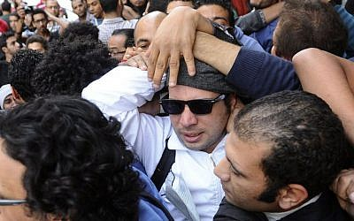 Ahmed Maher, with sunglasses, the leader of the April 6 youth group that had a leading role in the 2011 uprising against former Egyptian President Hosni Mubarak, Saturday, Nov. 30, 2013 (photo credit: AP /Ahmed Omar, File)