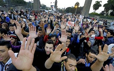 Egyptian protesters chant anti-police and military slogans as they march towards the Egyptian Cabinet in Cairo, Egypt, on Monday (photo credit: AP/Amr Nabil)