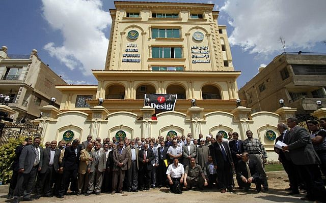 In this April 30, 2011 file photo, Egyptian Muslim brotherhood Shura council members gather to be photographed outside the new Muslim Brotherhood headquarters in Cairo, Egypt. (photo credit: AP/Khalil Hamra)
