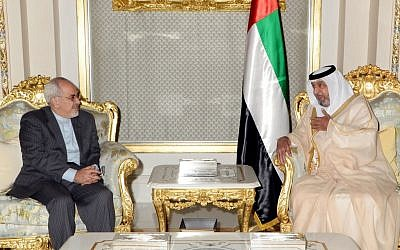 UAE President Sheikh Khalifa bin Zayed Al Nahyan (right) meets with Iranian Foreign Minister Mohammad Javad Zarif in Abu Dhabi, United Arab Emirates, on December 4, 2013. (photo credit: AP/WAM)