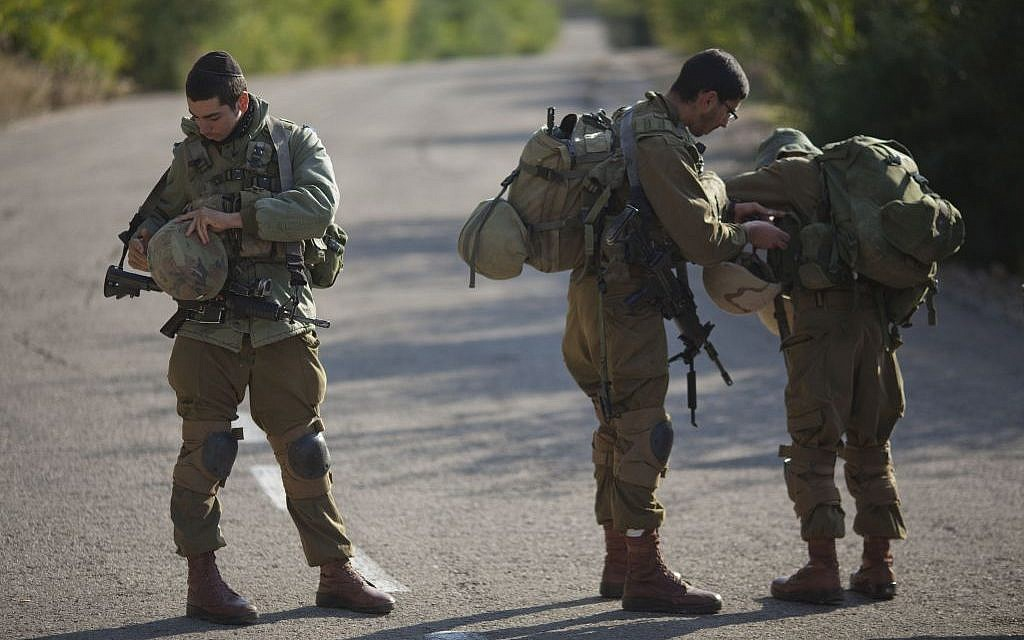 Israeli soldiers stand guard in Rosh Hanikra, Israel, near the border between northern Israel and Lebanon, on Monday, December 16, 2013. (photo credit: AP/Ariel Schalit)