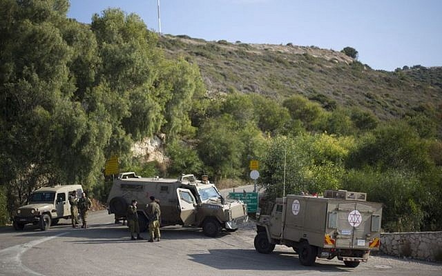 Israeli soldiers guard the area near the border between northern Israel and Lebanon, December 16, 2013. (photo credit: AP/Ariel Schalit)