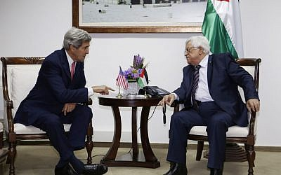 US Secretary of State John Kerry, left, meets Palestinian President Mahmoud Abbas in the West Bank city of Ramallah on Thursday, December 5, 2013.  (photo caption: AP/Mohamad Torokman, Pool)