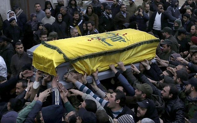 Lebanese mourners carry the coffin of a senior commander of the Lebanese group Hezbollah (photo credit: AP/Hussein Malla)