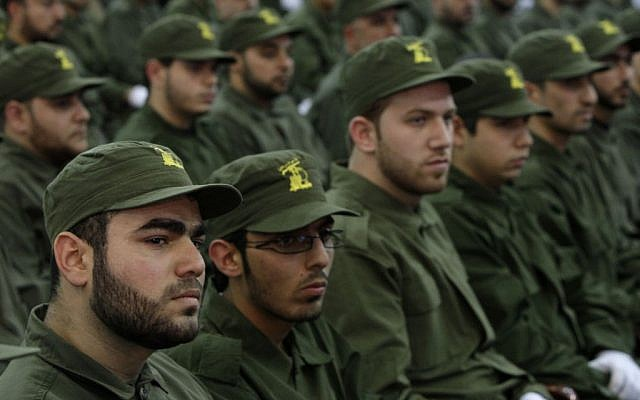 Hezbollah fighters attending a rally in Beirut, November, 2011.  (photo credit: AP/Bilal Hussein)