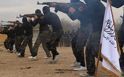 In this undated picture released on Friday, November 29, 2013, and posted on the Facebook page of a militant group, members of Ahrar al-Sham brigade, one of the Syrian rebels groups, exercise in a training camp at unknown place in Syria. (AP Photo)