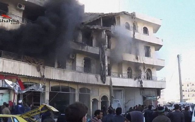 Smoke billows from a building after a blast in Aleppo, Syria, Thursday, December 19, 2013 (photo credit: AP/Shaam News Network via AP Video)