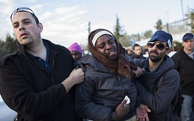 """Sudanese refugee get arrested by immigration police in front of the Knesset after marching towards Jerusalem from the south in protest of the new """"Holot"""" detention camp for illegal migrants, on Monday, December 17, 2013 (photo credit: Yonatan Sindel/Flash90)"""