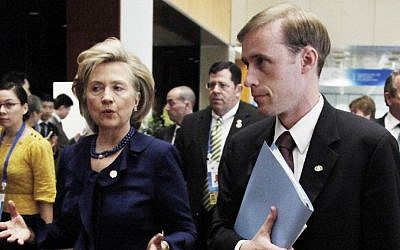 This Nov. 11, 2009 file photo shows then-Secretary of State Hillary Rodham Clinton walking with then-Deputy Chief of Staff Jake Sullivan in Singapore. (AP Photo/Ng Han Guan, File)