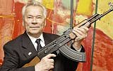 Russian weapon designer Mikhail Kalashnikov presents his legendary assault rifle to the media while opening the exhibition 'Kalashnikov - legend and curse of a weapon' at a weapons museum in Suhl, Germany, July 26, 2002. (AP/Jens Meyer)