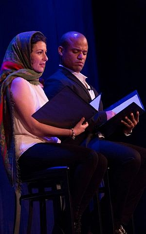 Actors Lisa Circincione and Gamal Palmer acting out author Dora Levy Mossanen's story, 'Soraya and the Mullah.' (photo credit: Joyce Culver)