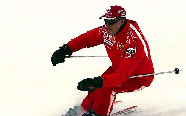 In this Thursday, Jan. 12, 2006 file photo provided by the Ferrari press office, Formula One driver Michael Schumacher of Germany speeds down a course in the Madonna di Campiglio ski resort, in the Italian Alps . (AP/Ferrari, File)