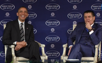 President Barack Obama, speaking (with Haim Saban) at the Saban Forum in Washington on December 7, laughs when asked if he and Prime Minister Benjamin Netanyahu would analyze the Geneva deal with Iran differently. (photo credit: Saban Forum screen shot)