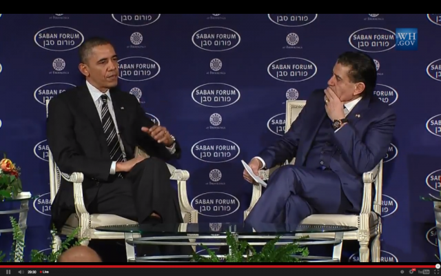 President Barack Obama speaks with Haim Saban at the Saban Forum on December 7, 2013 (photo credit: Saban Forum screenshot)
