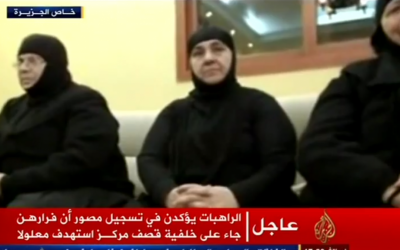 A group of kidnapped nuns appears in a video broadcast by Al Jazeera in early December (photo credit: YouTube screenshot)