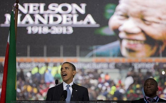 US President Barack Obama speaks to crowds attending the memorial service for former South African president Nelson Mandela at the FNB Stadium in Soweto near Johannesburg, Tuesday, December 10, 2013 (photo credit: AP/Evan Vucci)