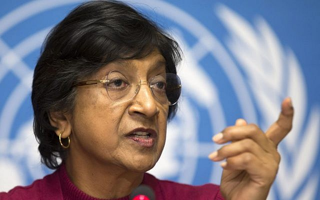 UN High Commissioner for Human Rights, South African Navi Pillay speaks during a news conference at the European headquarters of the United Nations in Geneva, Switzerland, Monday, Dec. 2, 2013. (photo credit: AP/Keystone, Salvatore Di Nolfi)