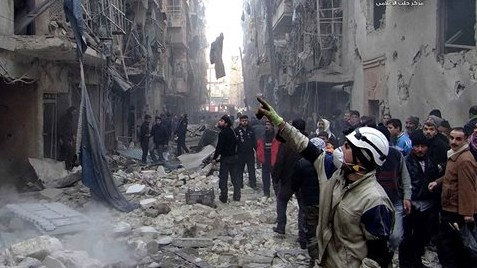 Syrians inspect damages buildings following a Syrian government airstrike in Aleppo, Syria, Sunday, Dec. 15, 2013 (photo credit: AP/Aleppo Media Center, AMC)