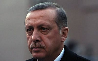 Turkey's Prime Minister Recep Tayyip Erdogan walks near his office in Ankara, Turkey, Wednesday, December 18, 2013. (Photo credit: AP/Burhan Ozbilici)
