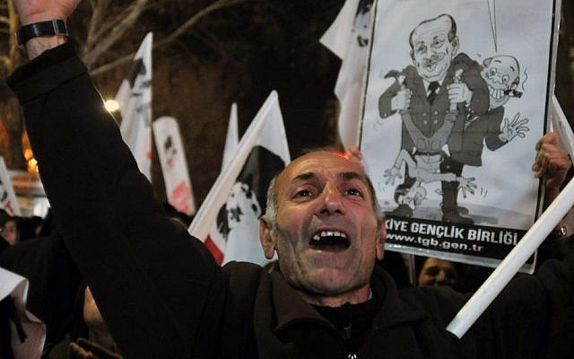 "A protester shouts "" catch the thief!..""as several hundred people call on the government to resign during a protest in Ankara, Turkey, late Friday, Dec. 27, 2013. (Photo credit: AP)"