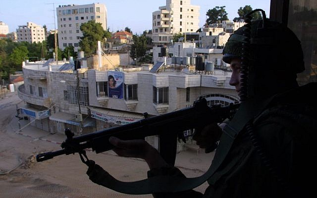 An Israeli soldier stands guard near the Church of the Nativity in Bethlehem, the scene of a stand-off between the Israeli army and a group of Palestinians who had taken refuge inside the Church, April 14, 2002 (photo credit: Flash90)