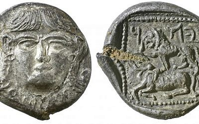 A 5th century silver drachm from Persian era Palestine with a gorgoneion on the obverse (left) and a lion and bovine on the reverse (right). Above the lion are the Aramaic letters yod, heh and dalet -- Judea. (photo credit: Vladimir Naikhin/The Israel Museum)
