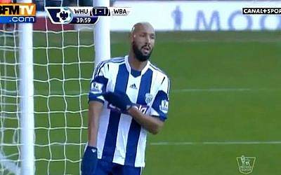 Nicolas Anelka makes the 'quenelle' gesture on December 28 (screenshot: YouTube)