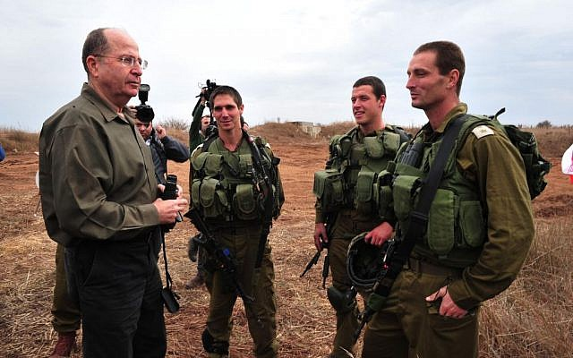 Defense Minister Moshe Ya'alon during a recent visit to the Golan Heights (Photo credit: Ariel Hermoni/ Ministry of Defense)