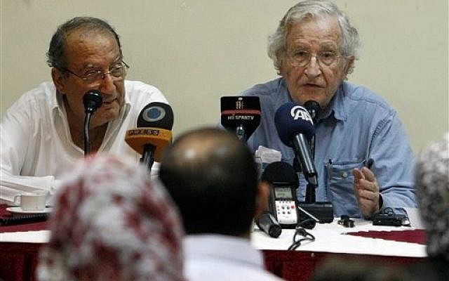 Gaza psychiatrist and prominent Palestinian human rights campaigner Dr. Eyad Sarraj, left, listens to Jewish-American scholar and activist Noam Chomsky, right, during a meeting with Palestinian youth activists at Almathaf hotel in Gaza City, October 19, 2012. (photo credit: AP/Adel Hana)