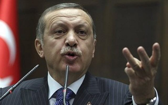Turkish Prime Minister Recep Tayyip Erdogan addresses lawmakers at the parliament in Ankara, Turkey. (photo credit: AP Photo/File)