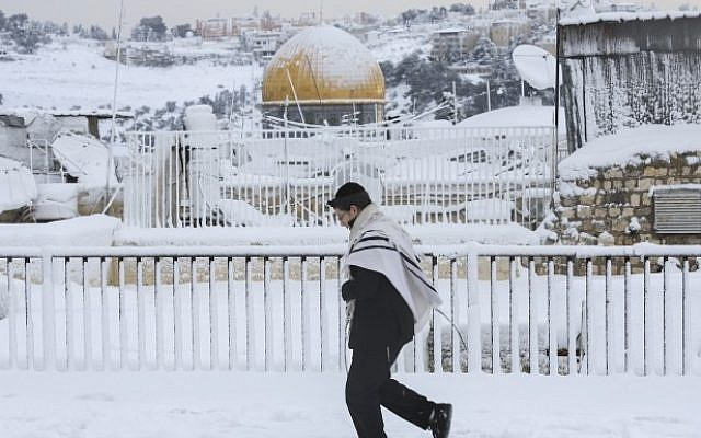 The Dome of the Rock is seen in the background in Jerusalem's Old on a snowy winter day on Friday, December 13, 2013. (Photo credit: Nati Shohat/Flash90)