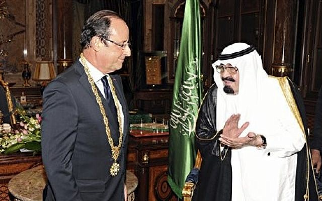 King Abdullah of Saudi Arabia, right, applauds French President Francois Hollande, left, after presenting him with the Order of Merit in Jiddah, Saudi Arabia, Sunday, Nov. 4, 2012  (photo credit: AP/SPA, File)