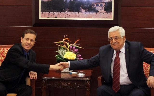Newly elected leader of the Israeli Labor party Isaac Herzog meets with Palestinian President Mahmoud Abbas in the West Bank city of Ramallah. December 01, 2013 (photo credit: Issam Rimawi/Flash90)