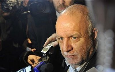 Iran's Minister of Petroleum Bijan Zangeneh talks to journalists as he arrives at a hotel in Vienna, Austria, on Tuesday, Dec. 3, 2013 (photo credit: AP Photo/Hans Punz)