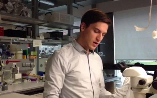 Sam 'Ushy' Katz rocks out to a hassidic niggun in the lab. (photo credit: screenshot)
