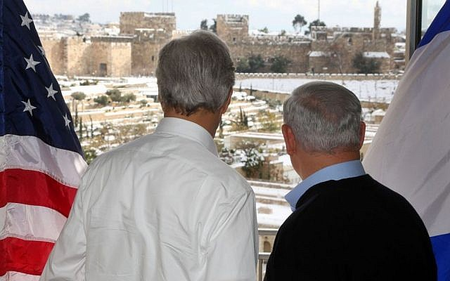 Visiting Secretary of State John Kerry and Prime Minister Benjamin Netanyahu look out at the snow from the balcony of a Jerusalem hotel on December 13, 2013. The suite's balcony overlooks the Old City walls of Jerusalem and the Jaffa Gate area amid a major snow storm (Photo credit: Marc Israel Sellem/POOL/Flash 90.)