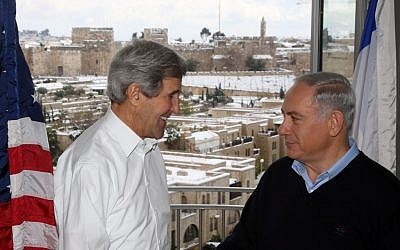 Secretary of State John Kerry meets with Prime Minister Benjamin Netanyahu in a Jerusalem hotel on December 13, 2013. The suite's balcony overlooks the Old City walls of Jerusalem and the Jaffa Gate area amid a major snow storm (Photo credit: Marc Israel Sellem/POOL/Flash 90.)