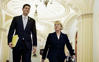 The House Budget Committee chair, Rep. Paul Ryan, and the Senate Budget Committee chair, Sen. Patty Murray, walk past the Senate chamber on their way to a press conference to announce a bipartisan budget deal, Dec. 10, 2013. (photo credit: T.J. Kirkpatrick/Getty Images/JTA)