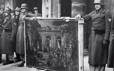 Nazis holding looted art (YouTube screenshot)
