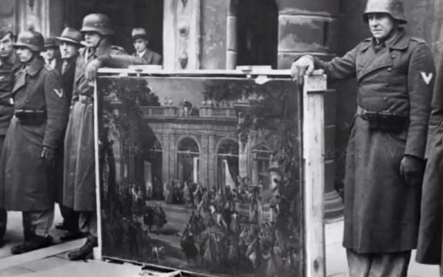 Nazis holding looted art (photo credit: YouTube screenshot)