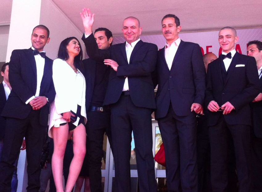 The 'Omar' cast with Abu-Assad in the middle at Cannes, where the film won the Jury Prize (Courtesy Omar by Hany Abu-Assad Facebook page)