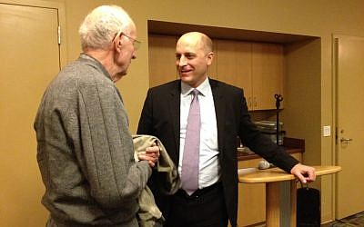 Gidi Grinstein speaks to an audience member following his book launch event at the Palo Alto JCC. (photo credit: Renee Ghert-Zand)