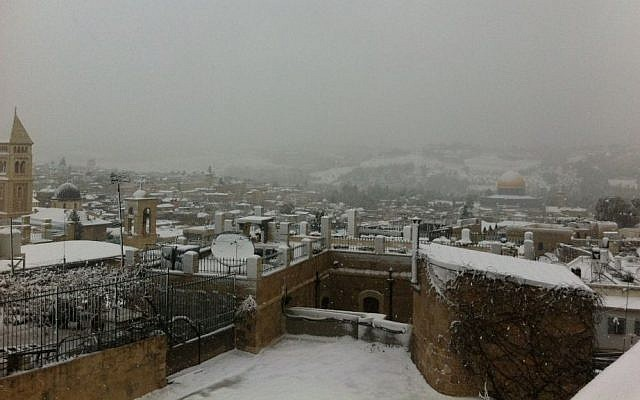 A view of Jerusalem's snow-blanketed Old City, Thursday, December 12, 2013 (photo credit: Tamar Pileggi/Times of Israel)