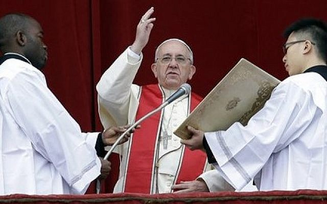Pope Francis delivers his 'Urbi et Orbi' (to the City and to the World) message from the central balcony of St. Peter's Basilica at the Vatican, Wednesday, December 25, 2013. (photo credit: AP/Gregorio Borgia)