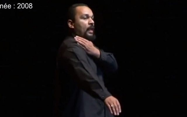 French comedian Dieudonne M'bala M'bala performing the quenelle in 2008 (photo credit: YouTube screenshot)